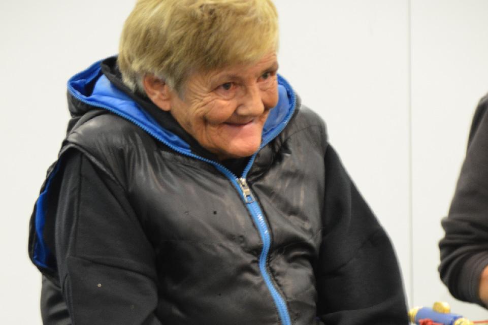 Smiling woman wearing puffer jacket.