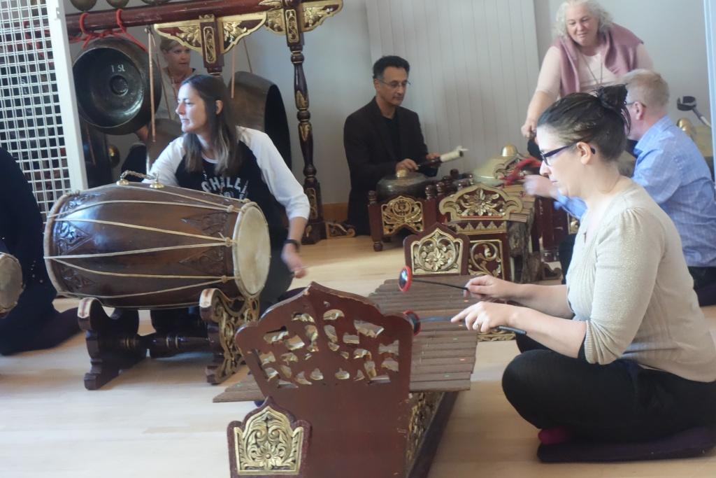 5 white people playing gamelan together.