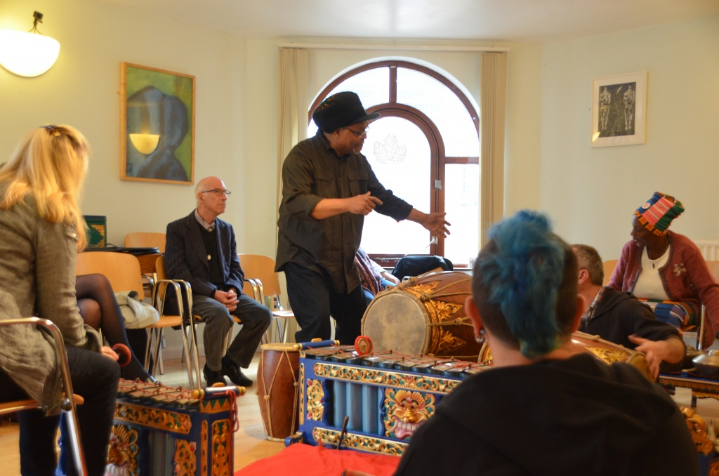 A group of people playing gamelan and dancing.